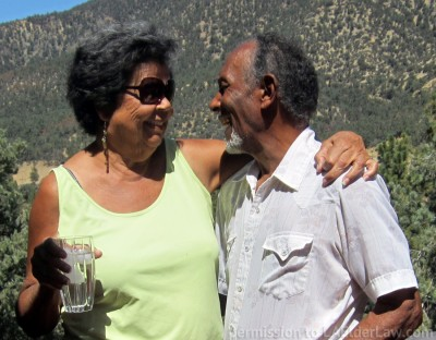 Couple happily smiling at one another, having avoided the costs of Probate,